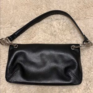 Wilson leather clutch. zippered Magnet enclosure.